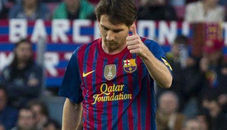 El delantero argentino del FC Barcelona Leo Messi celebra la consecución de un gol ante el Málaga. EFE